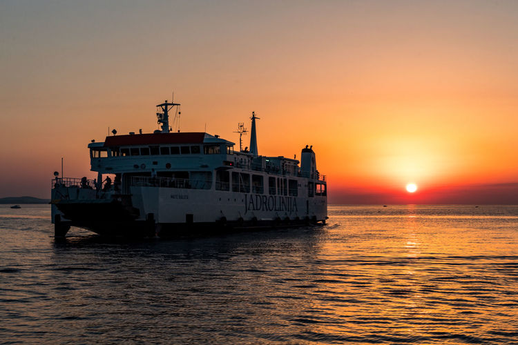 Ferry in sunset Ferry Zadar Zadar Sunset Zadar,Croatia Beauty In Nature Cruise Ship Idyllic Mode Of Transportation Nature Nautical Vessel Orange Color Outdoors Passenger Craft Scenics - Nature Sea Ship Sky Sun Sunset Tranquil Scene Tranquility Transportation Travel Water Waterfront