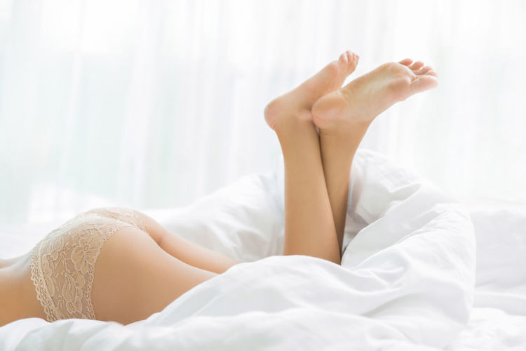 Adult barefoot Beautiful Woman Bed Bedroom Body Part Comfortable Cozy Domestic Room Feet Up Furniture Human Body Part Human Foot Human Leg Indoors  Lifestyles Limb Low Section Lying Down Lying On Back One Person Relaxation Resting Young Adult Young Women