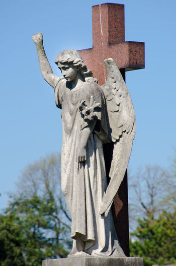 Statue of Angel on cross Angel Cross Death Holy Human Representation Religous Sculpture Sky Statue Symbol