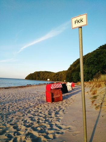 Road Sign Beach Outdoors Sand Day Sky Adults Only Full Length Only Men Vacations Tree People Adult Sea One Man Only Travel Destinations Ostsee Rügen Lovers Vacations Beachphotography Fkk