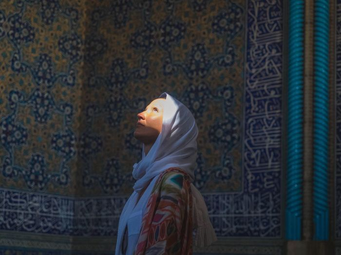 Woman in hijab looking up