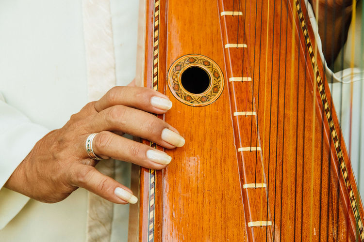 Close-up of woman playing harp