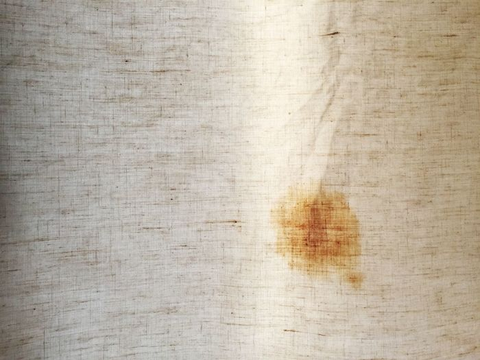 Close-Up Of Tea Stains Linen Texture