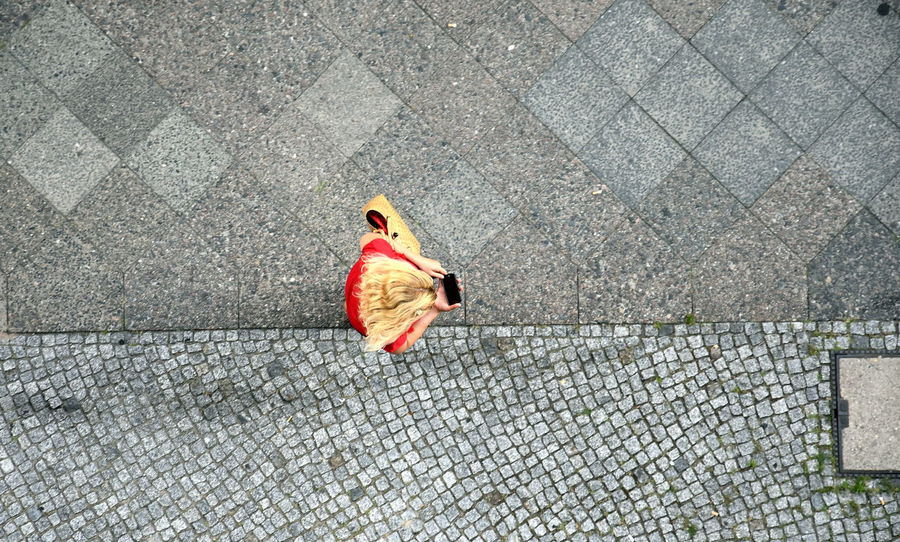 Navigation Navigational Compass Mobilphone Handy GPS Kompass Compass Best Friend colour of life Streetphotography StreetArtEverywhere Portrait Portrait Of A Woman The Street Photographer - 2018 EyeEm Awards Full Length Road High Angle View Red #urbanana: The Urban Playground