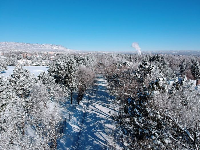 Suburban Snow Road. Nature Winter Snow Beauty In Nature Cold Temperature Tranquility Landscape Tranquil Scene Day No People Outdoors Clear Sky Tree Blue Scenics Mountain Sky