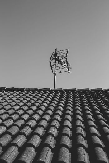 Low angle view of roof of building against clear sky