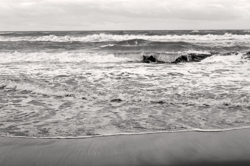 Background Monochrome Black And White Winter Sea Green Color Grey Leaden Day Loneliness Sea Wave Water Motion Aquatic Sport Surfing Beauty In Nature Horizon Over Water Sport Scenics - Nature Horizon Beach Land Nature Sky Outdoors Day Power In Nature Flowing Water