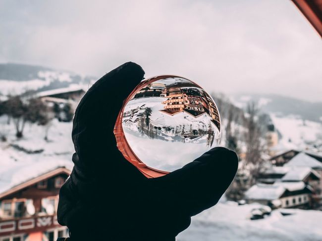 Lens Ball Lensball Snow Winter Cold Temperature Weather Outdoors Focus On Foreground Day One Person Real People Nature Leisure Activity Sky Mountain Scenics Close-up Frozen Beauty In Nature Landscape Building Exterior Human Hand