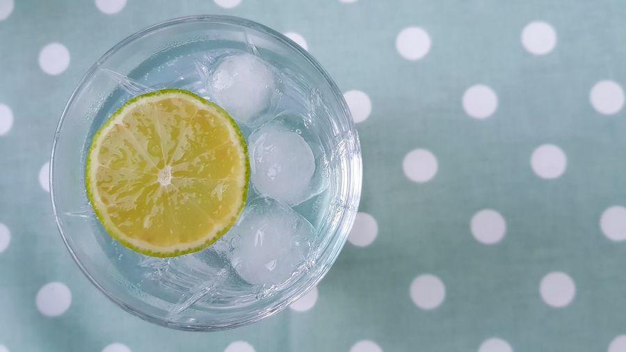 Close-up of lemon slice on glass table