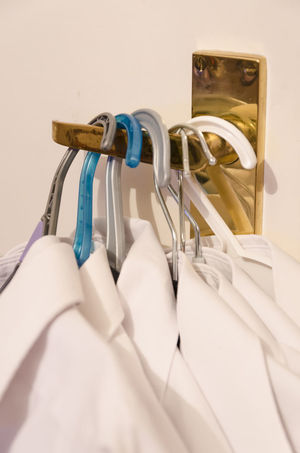 Newly ironed white shirts on hangers hanging on a brass door handle. Brass Door Handle Close-up Clothes Clothes Hangers Coat Hangers Door Handle Hangers Ironed No People Shirts White Shirts