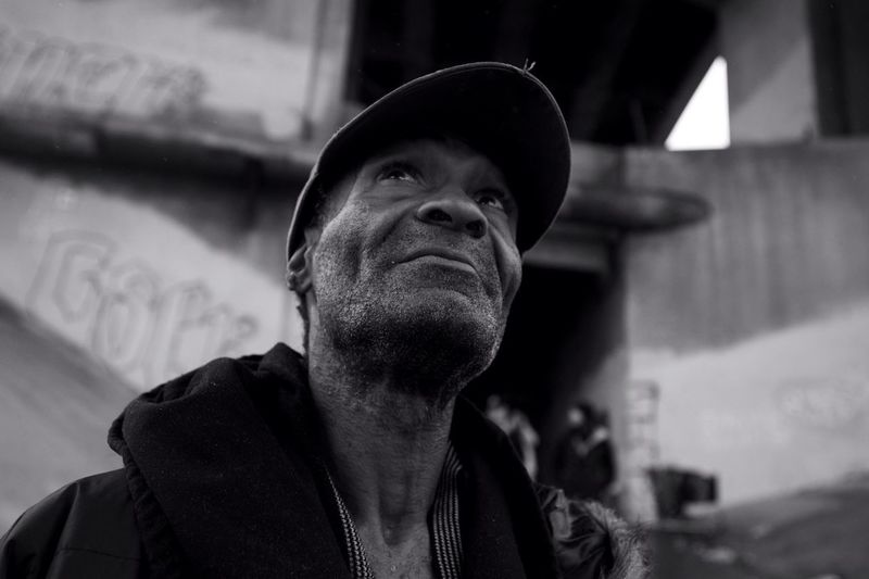 Just to the south of the 6th Street Bridge and below the railroad tracks sits a drainage grate that feeds the LA River. It is here that Tracy calls home, where he is dealing quietly with prostate cancer and AIDS. Originally from Chicago, he came to LA to