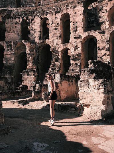 Enjoying The Sun World Love Travel Tunisia Amphitheater Rome путешествия Гладиаторы амфитеатр Sunlight Shadow Real People Day Lifestyles Nature One Person