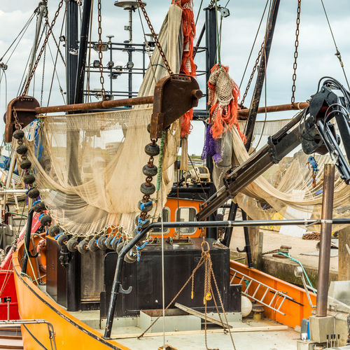 Fishing Vessel waiting for high tide Brancaster Staithe EyeEmNewHere Sea Vessel Day Employment Fishing Boat Floats Livelihood Mode Of Transport Nautical Vessel Occupation Outdoors People Transportation Trawler Trawler Nets Winch