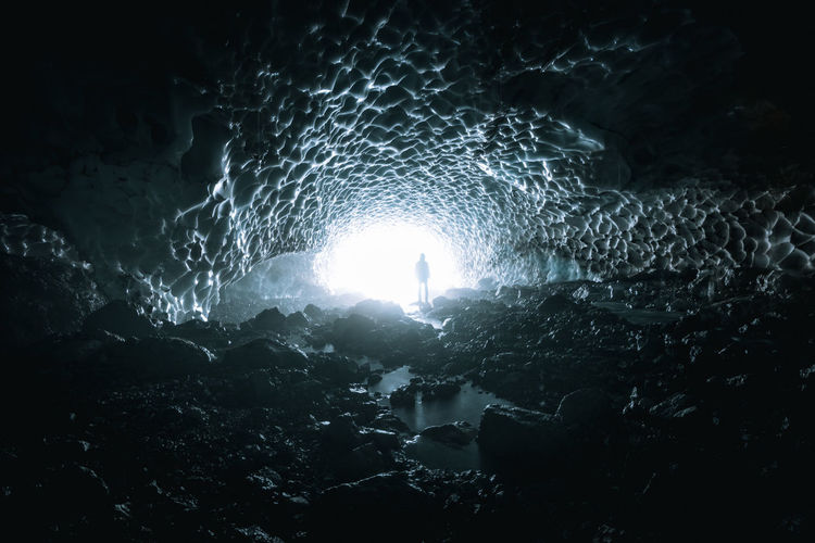 Person Standing In Frozen Cave