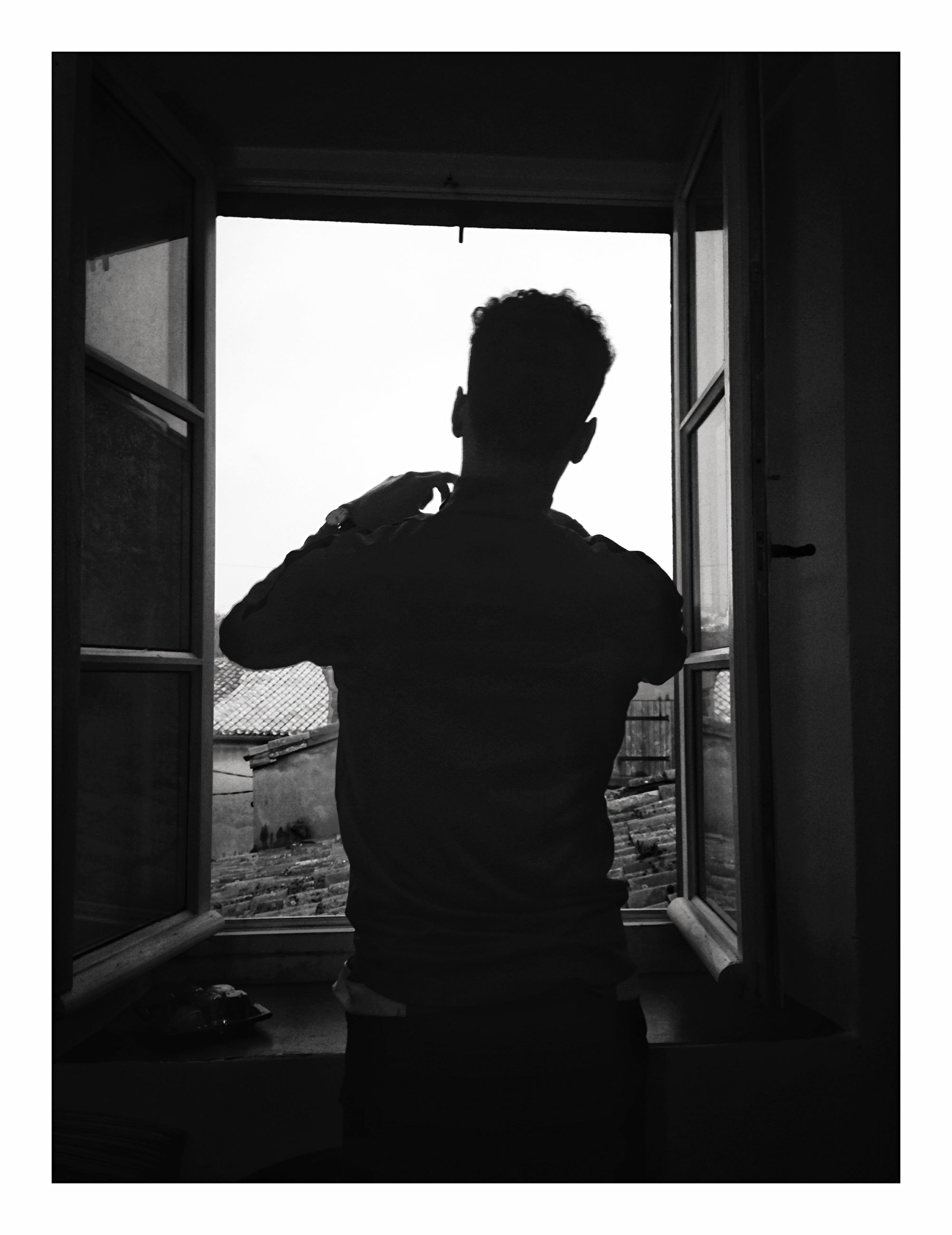 one person, standing, real people, transfer print, auto post production filter, men, rear view, indoors, leisure activity, three quarter length, lifestyles, window, silhouette, domestic room, day, nature, home interior, adult, contemplation