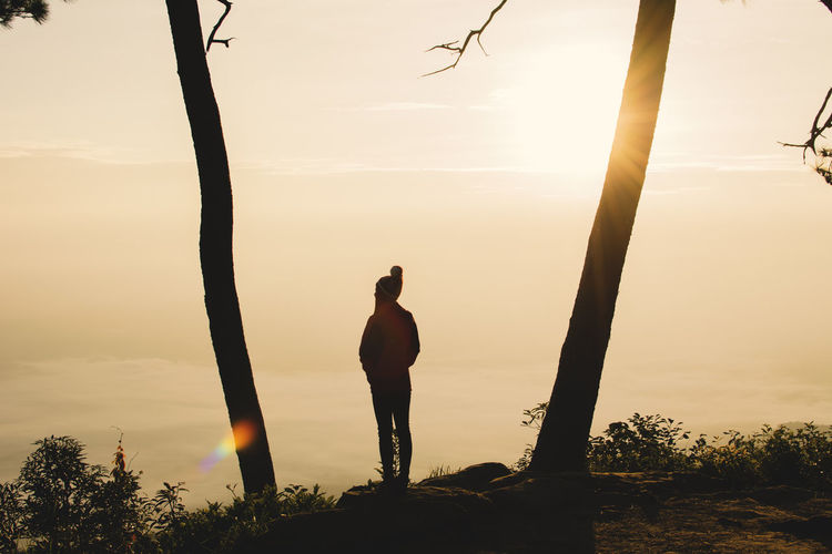 Beauty In Nature Lifestyles Nature One Person Outdoors Real People Silhouette Sky Standing Tree