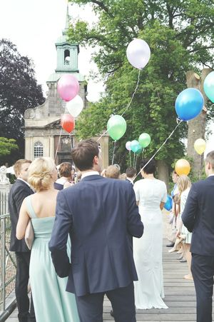 Making the world more colorful. People Guests Holding Colored Balloons Dressed Up Wedding Well Wishes Silhouettes Sky Church Chapel The Photojournalist - 2016 EyeEm Awards The Street Photographer - 2016 EyeEm Awards EyeEm Best Shots Watching People Happy Day Outdoors Trees From My Point Of View Wedding Photography Architecture Architectural Detail Signal Looking Up