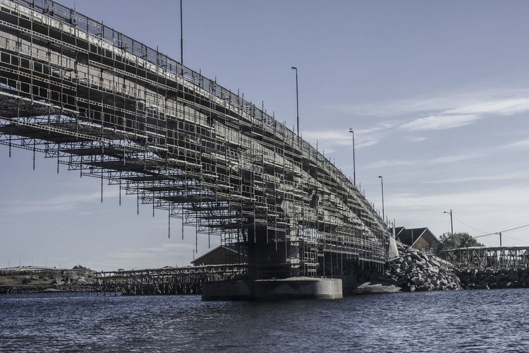 Unfinished Bridge in Lofoten, Taken from a boat. Bridges Construction Site Lofoten Norway Norway Architecture Bridge Bridge - Man Made Structure Building Exterior Built Structure Cloud - Sky Connection Day Nature No People Outdoors River Sky Transportation Unfinished Water Waterfront