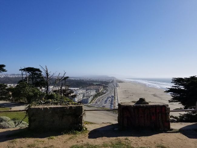 Sutro Park view of Ocean Beach and highway Highway View From The Top Sutro Park Blue Sky And Clouds Trees Concrete Blocks Day Sunny Water Sky Shore Ocean