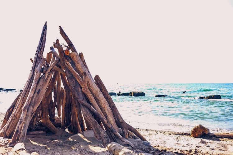 Abandoned Beach Boat Damaged Destruction Escapism Log Nautical Vessel Obsolete Old Outdoors Sand Sea Shore Summer Vacations Voyage Water Wood Wood - Material