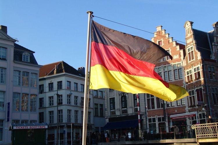 Flag of belgium in front of building