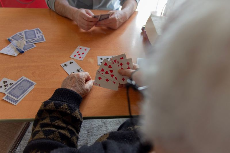 Grandpa playing cards Cards Game Old People Leisure Games Human Body Part Leisure Activity Playing Human Hand Table Relaxation Hand Real People Indoors  Men Cards Poker - Card Game Body Part