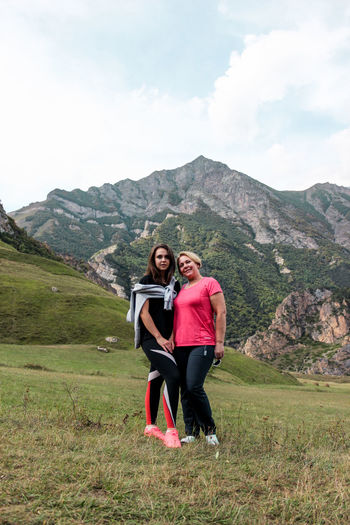 Full length of women standing against mountain range