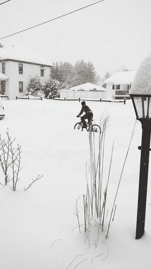 Winter blizzard snow bike ride cold weather