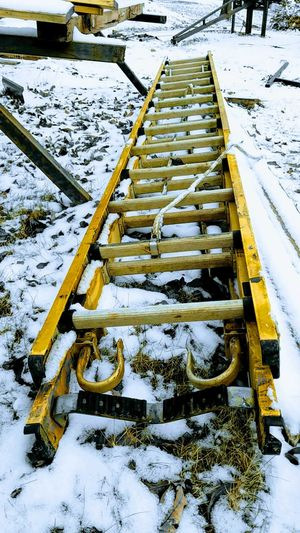 going down Ladder Down Up Or Down Snow Cold Temperature Winter Weather High Angle View No People Frozen Outdoors The Graphic City