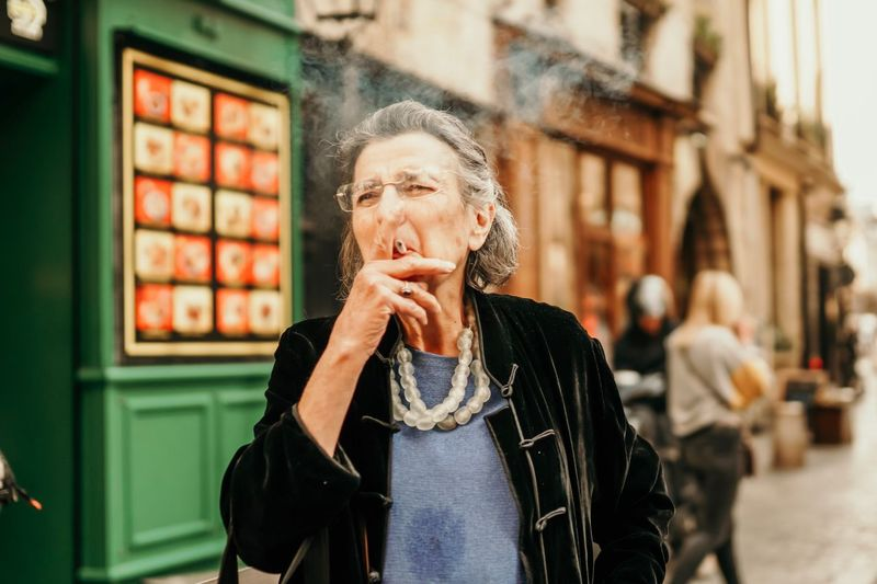 Paris Smoke One Person Lifestyles Adult Real People Women Leisure Activity Architecture Front View Standing Clothing Portrait City Beautiful Woman Warm Clothing Casual Clothing The Art Of Street Photography