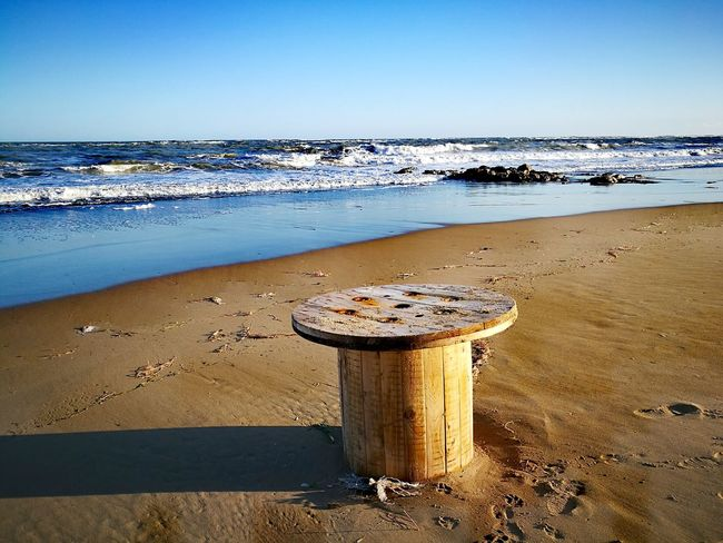 Beach Sea Water Sand Sky Nature Outdoors Sunset Scenics Horizon Over Water No People Refraction Day Abandoned Object Wooden Tools Wooden Finding New Frontiers