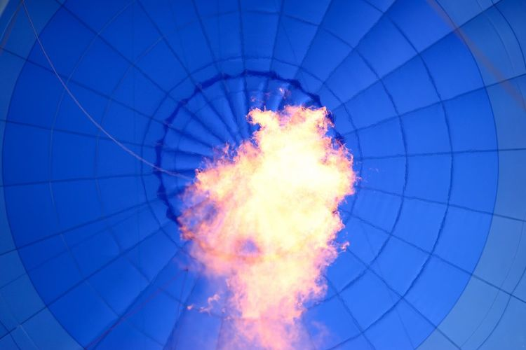 Directly Below Shot Of Fire In Hot Air Balloon