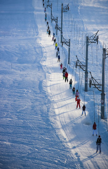 High angle view of people on snow and skilift