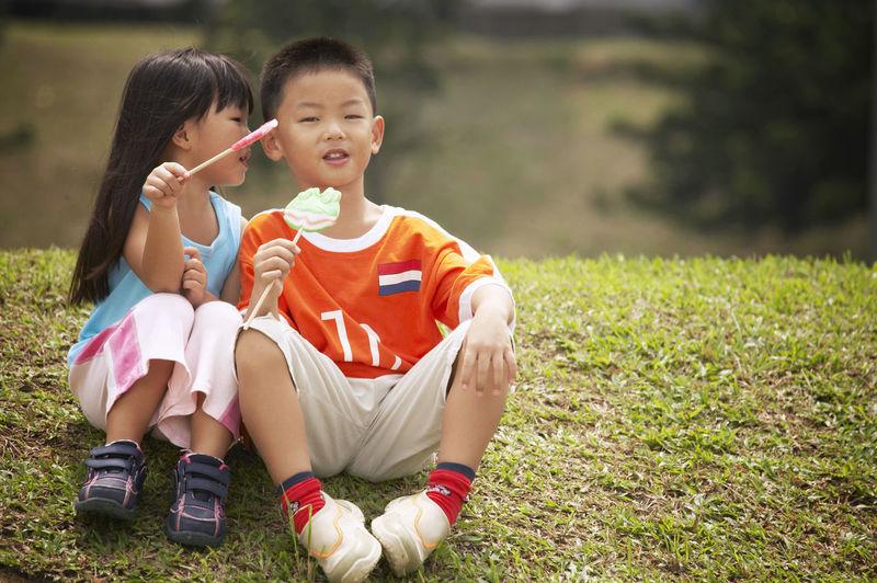 Siblings on field at park