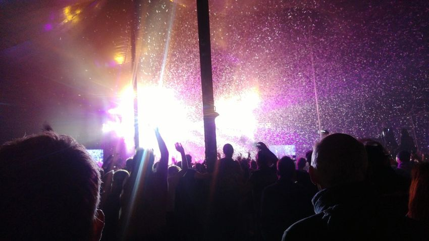 Nightlife Arts Culture And Entertainment Large Group Of People Crowd Night Silhouette Music Festival Music Popular Music Concert Enjoyment Audience Fun Excitement Illuminated Stage Light Purple Performance Event Youth Culture Stage - Performance Space