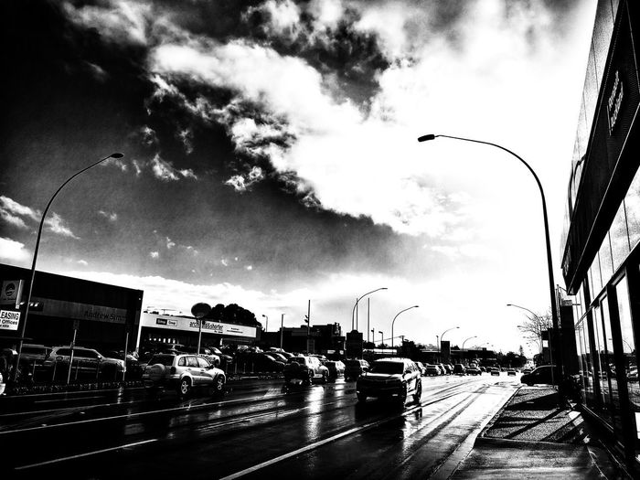 A brief moment of winter sun after heavy rain. B&w Blackandwhite Black And White City Road Land Vehicle Car Street Sky Cloud - Sky