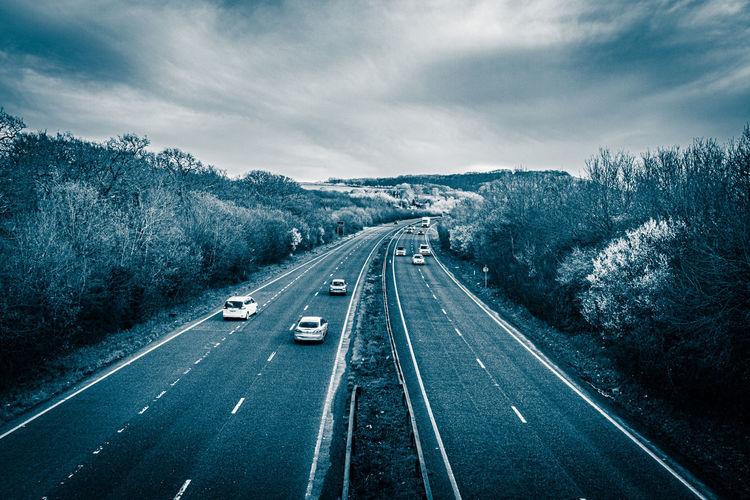 Aerial view of highway against sky