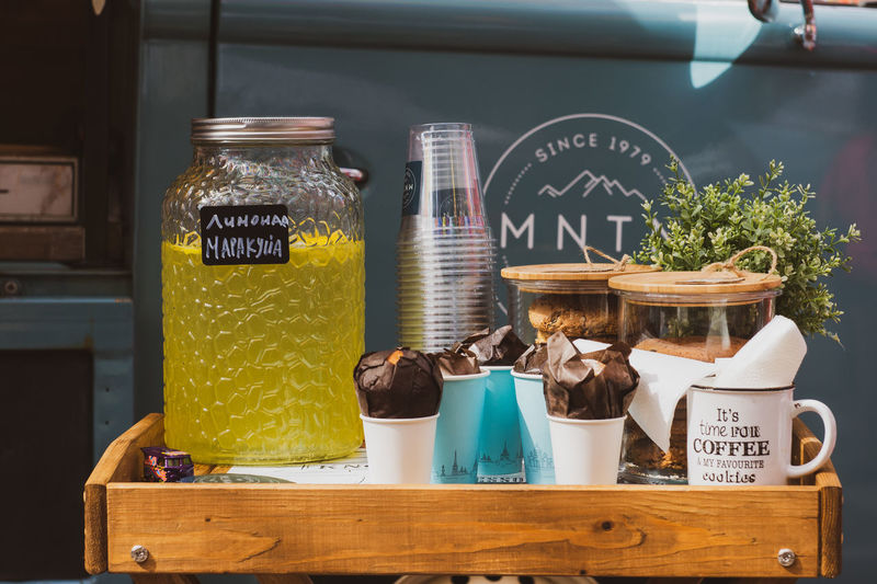 Tray with lemonade, coffee and muffins. Coffee Tray Bottle Choice Container Food Food And Drink For Sale Freshness Glass - Material Jar Limonade Muffin No People Retail  Retail Display Still Life Table
