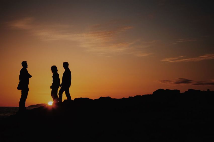Adult Beauty In Nature Bonding Friendship Full Length Leisure Activity Men Mountain Nature Outdoors People Real People Silhouette Sky Sunset Togetherness Women