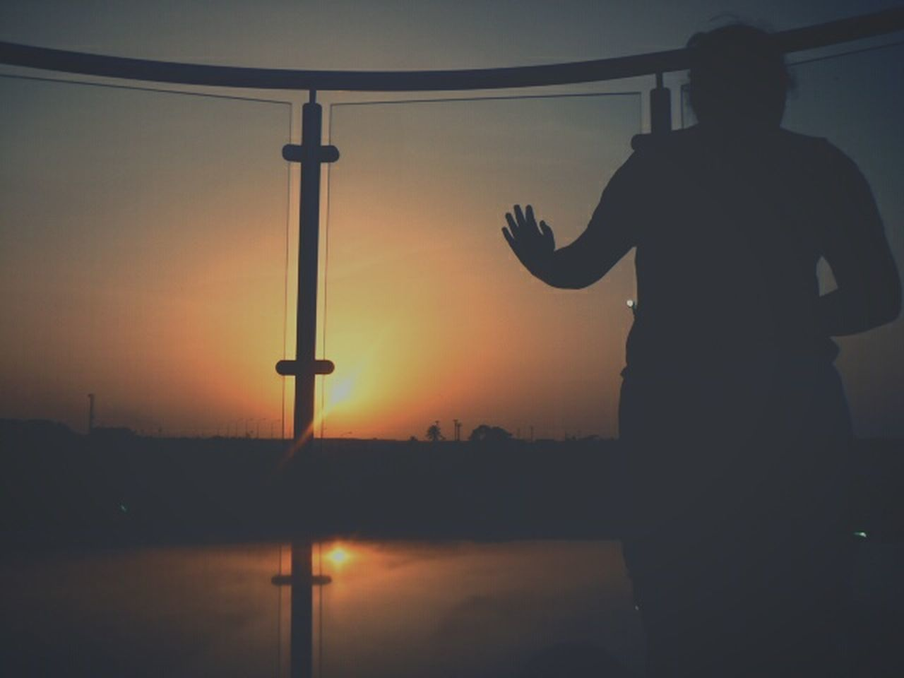 sunset, silhouette, real people, orange color, sky, standing, one person, lifestyles, outdoors, men, technology, nature, beauty in nature, water, people