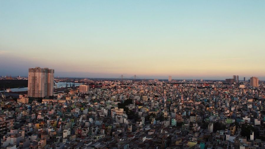 View of cityscape against clear sky during sunset