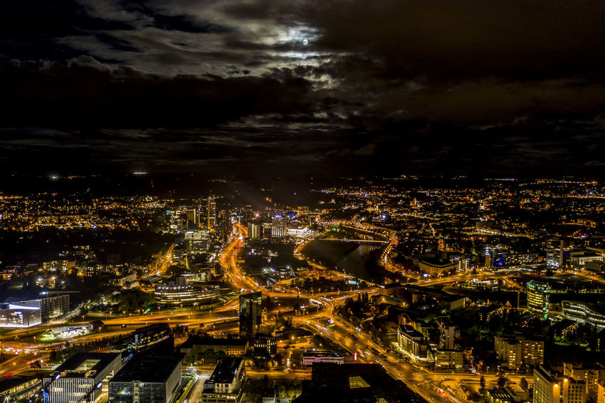 Vilnius at night over the full moon Aerial View Architecture Building Building Exterior Built Structure City City Life Cityscape Cloud - Sky Crowd Crowded High Angle View Illuminated Nature Night Nightlife Office Building Exterior Outdoors Residential District Settlement Sky Skyscraper