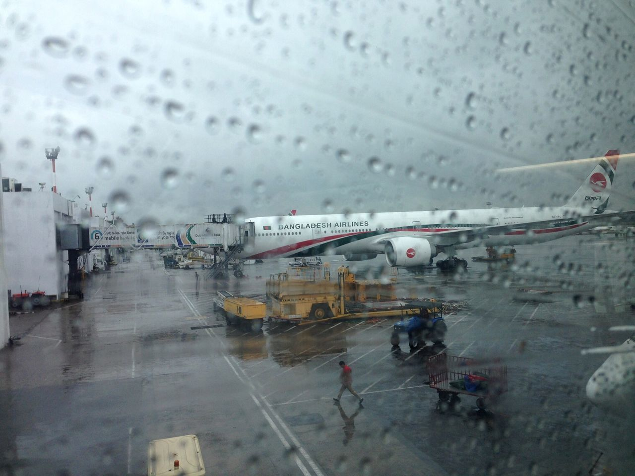 rain, wet, weather, transportation, rainy season, drop, window, raindrop, mode of transport, travel, airplane, public transportation, water, day, airport, airport runway, indoors, large group of people, snowing, cold temperature, sky, people