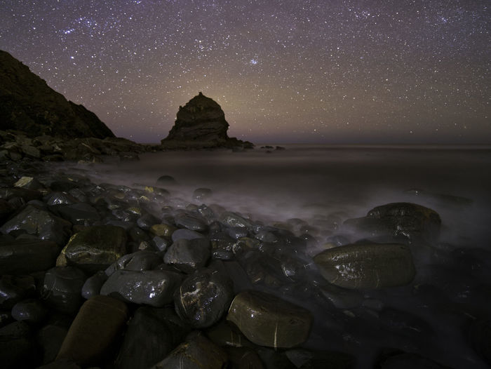 Praia da Ponta Ruiva Sky Scenics - Nature Night Water Beauty In Nature Tranquil Scene Star - Space Rock Solid Rock - Object Astronomy Tranquility Long Exposure Nature Space Sea Beach Land No People Horizon Over Water