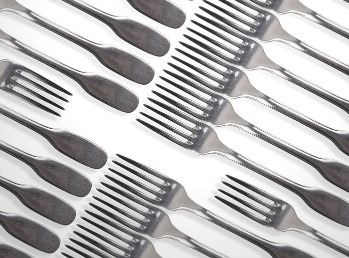 High angle view of forks over white background