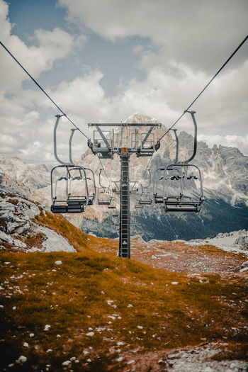 Overhead Cable Cars Against Cloudy Sky During Winter