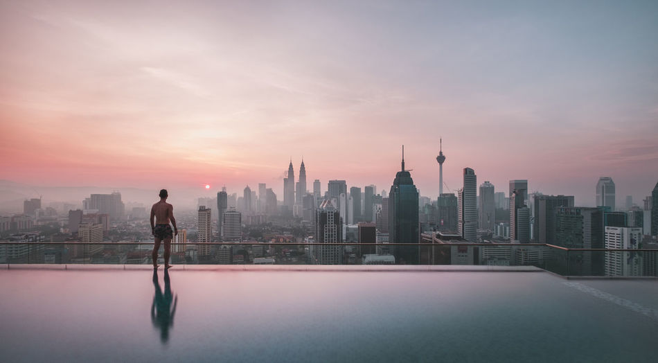 Standing at this infinity pool and watching the sunrise in Kuala Lumpur was one breathtaking experience. Highlight of my travel in Malaysia! City City Cityscape Day EyeEm Best Shots Infinity Pool Kuala Lumpur Malaysia One Person Outdoors Petronas Twin Towers Photography Pink Sky Reflection Sky Skyline Skyscraper Sunrise Sunrise Silhouette Sunrise_Collection Travel Destinations Twilight Urban Urban Skyline Viewpoint Market Bestsellers 2017