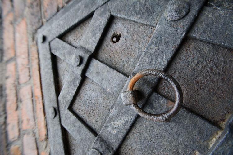 High angle view of old metal door