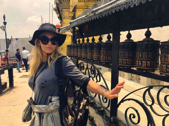 Swayambhunath Nepal Monkeytemple Sunglasses Real People Built Structure Lifestyles Young Women Ancient Civilization Women Nepalese Culture Exploration Ancient History Travel Destinations Place Of Worship Standing Religion Spirituality Kathmandu Adventures