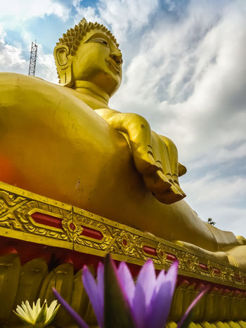 Beautiful Big Buddha Statue with a blue cloudy sky with light clouds at Phra Tanak Hill, Khao Phra Bat Temple in Pattaya, Thailand Big Buddha Pattaya Pattaya Thailand Art And Craft Big Buddha Temple Big Buddha Statue Cloud - Sky Craft Day Gold Gold Colored Golden Color Human Representation Low Angle View Male Likeness No People Outdoors Place Of Worship Religion Sculpture Sky Spirituality Statue Travel Destinations Yellow